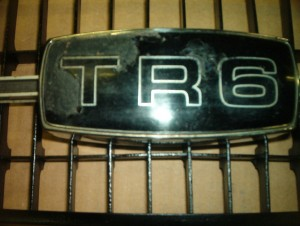 TR6 grill good shape chipped medallion,$125